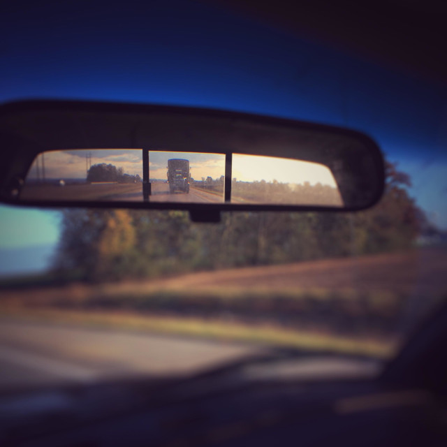 """Creepy Semi- truck in the rear view mirror."" stock image"