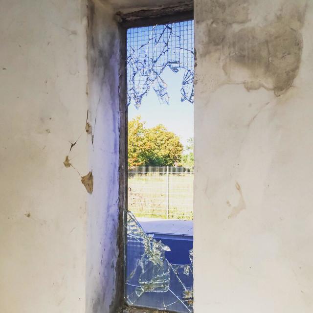 """""""Broken window in abandoned building"""" stock image"""