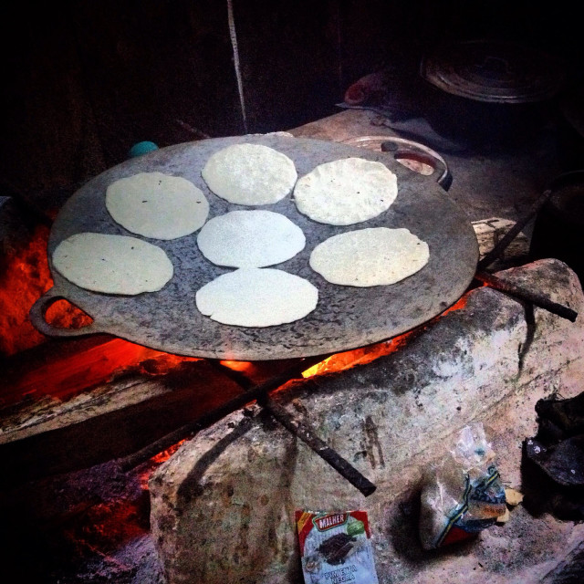 """""""Hand made corn tortillas in the fire in the Mayan city of Mirador, Peten, Guatemala"""" stock image"""