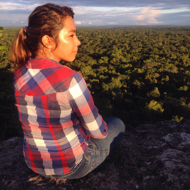 """""""A teenager watches the sunset in the Mayan city of Mirador, Peten, Guatemala"""" stock image"""