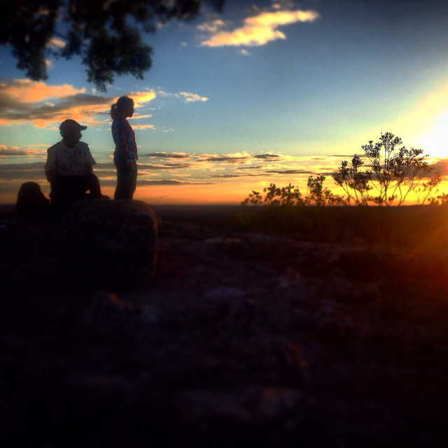 """""""People watch the sunset from the Danta pyramid in the Mayan city of Mirador, Peten, Guatemala"""" stock image"""