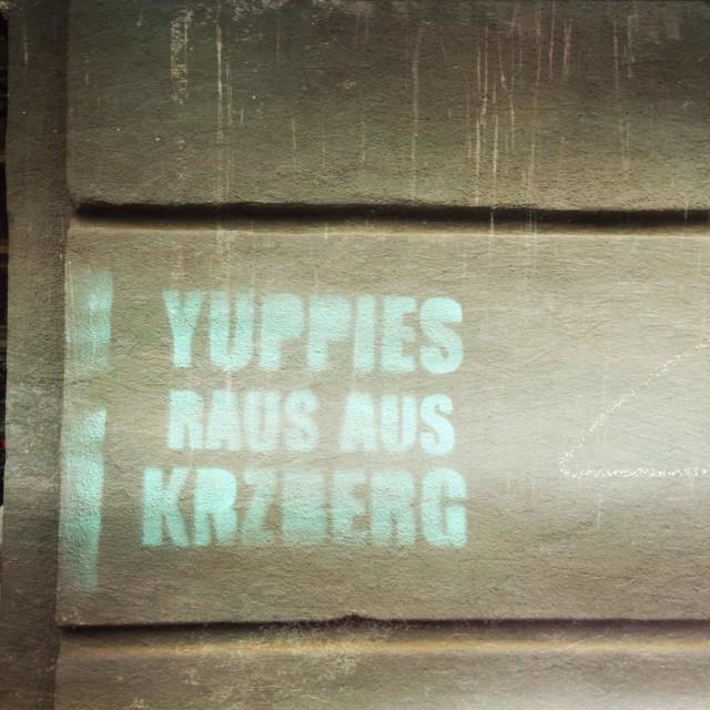 """Yuppies get out of Kreuzberg graffiti"" stock image"