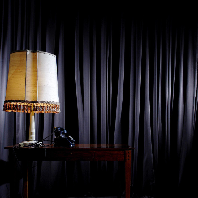 """""""Mid 30s setup... A table, a lamp and an old rotary phone"""" stock image"""