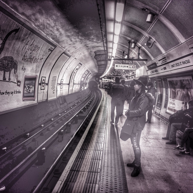 """""""People waiting for a team at kings cross St Pancras London Underground station"""" stock image"""