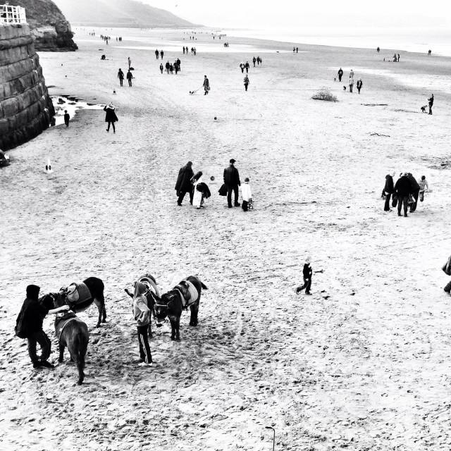 """Beach scene at Whitby"" stock image"