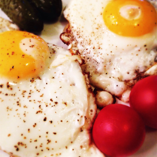 """""""Fried eggs tomatoes and pickled cucumber"""" stock image"""
