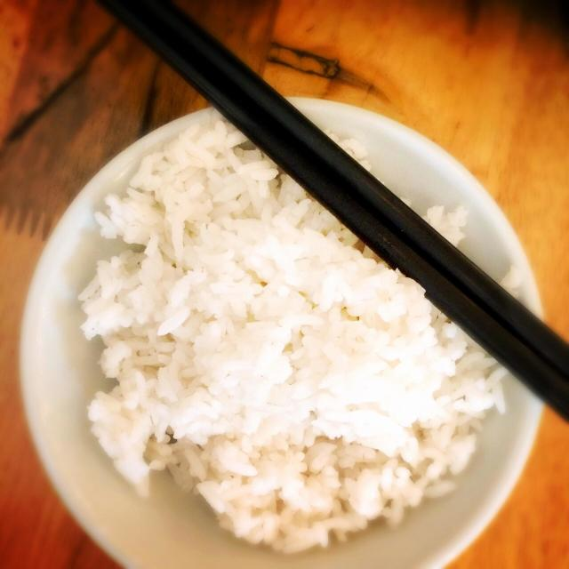 """A bowl of white rice with chopsticks"" stock image"