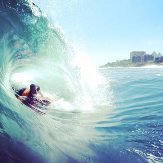"""""""Surf in shorebreak"""" stock image"""
