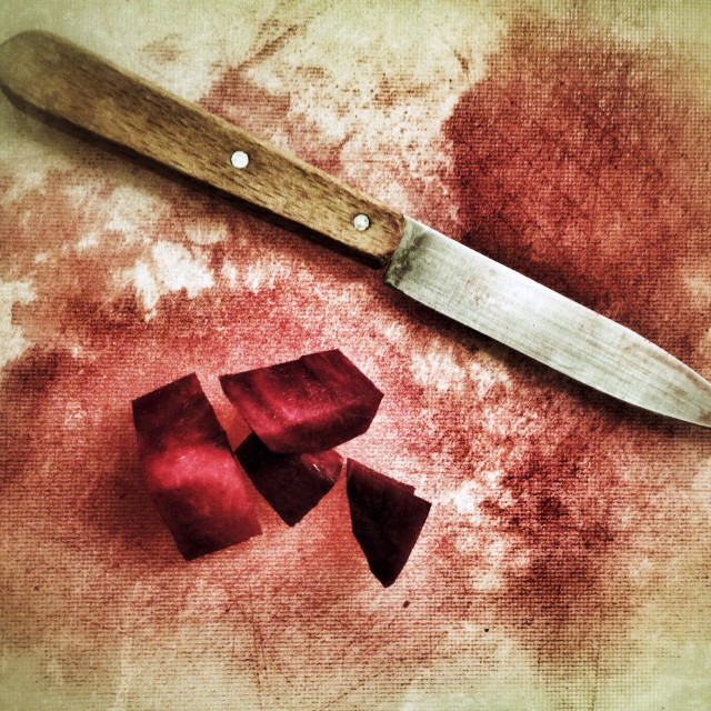 """""""Cut up beetroot and a knife on a plastic cutting board looks like slaughtered"""" stock image"""