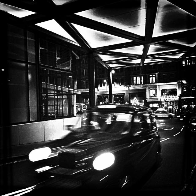 """Black cab at night, Knightsbridge, Central London, England, United Kingdom, Europe"" stock image"