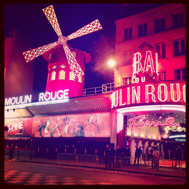 """""""Moulin Rouge in Paris lit up at night"""" stock image"""