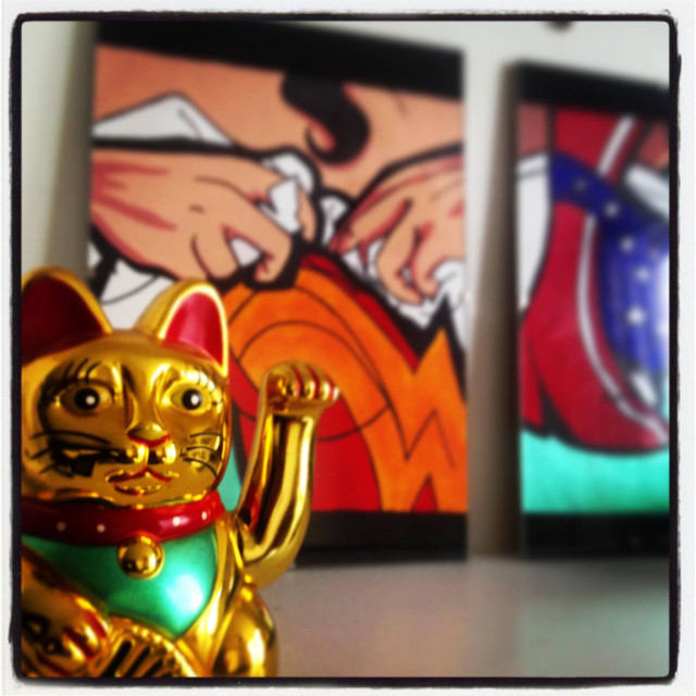 """""""Waving luck fortune cat in front of comic book artwork"""" stock image"""