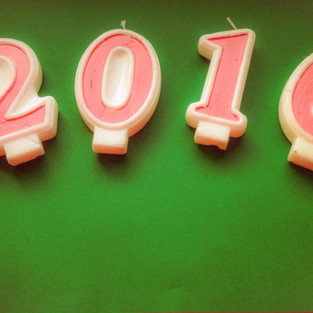 """2016 made of digit candels on green background"" stock image"