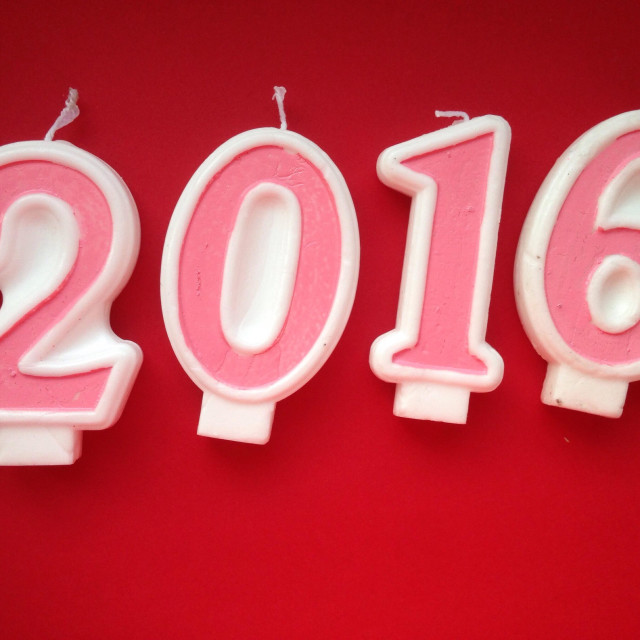 """2016 written with digit candels on red background"" stock image"