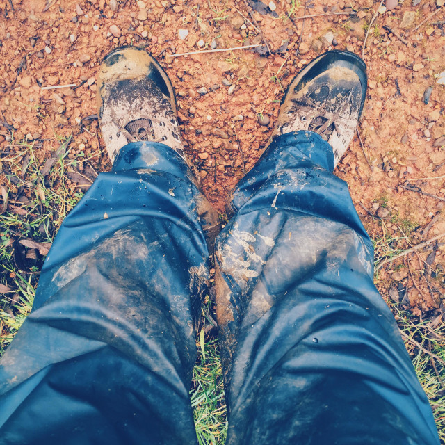 """""""Pair of legs wearing waterproof trousers and walking boots"""" stock image"""