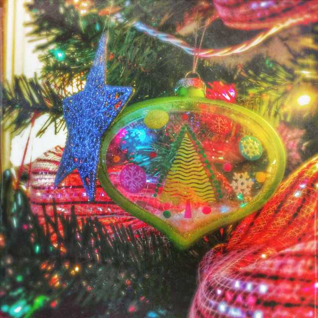 """""""A snow globe ornament and a glittery star on the Christmas tree."""" stock image"""
