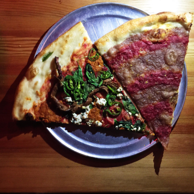"""Sizzle Pie vegan pizza slices from Portland, Oregon"" stock image"