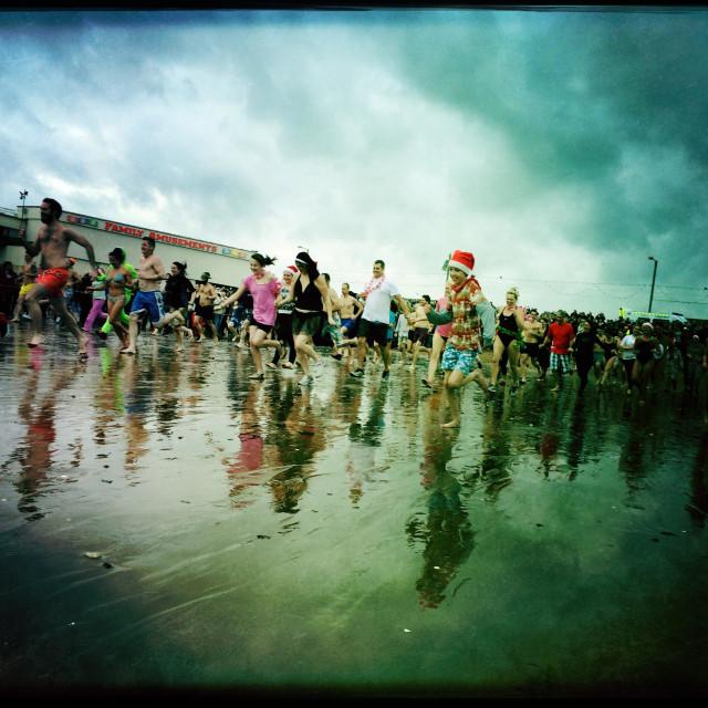 """""""Boxing Day swim in the sea in Paignton"""" stock image"""
