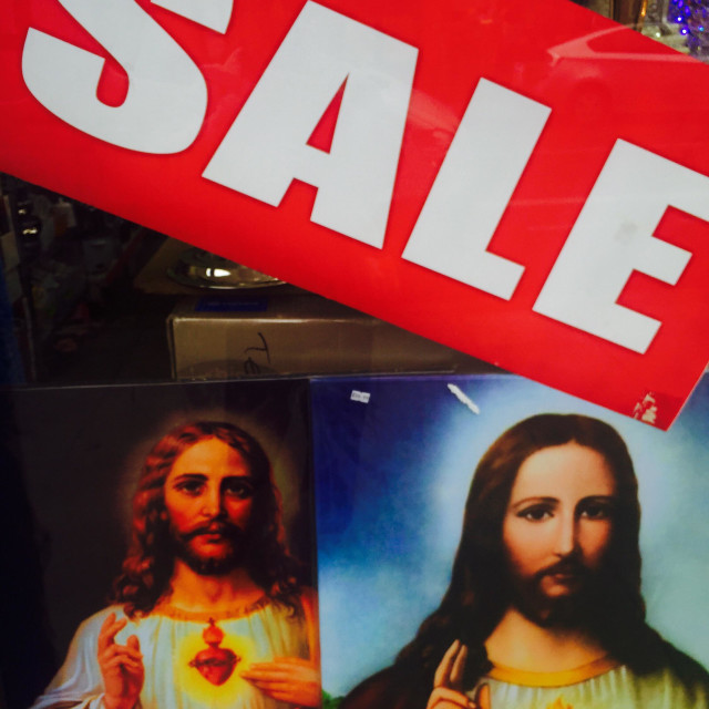 """""""The commercialisation of Christmas, noted with irony, as I photographed these posters of Jesus in the sales immediately after the festive season."""" stock image"""