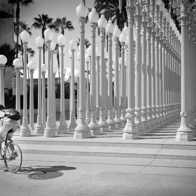 """""""Cyclist posing in front of Urban Light at LACMA"""" stock image"""