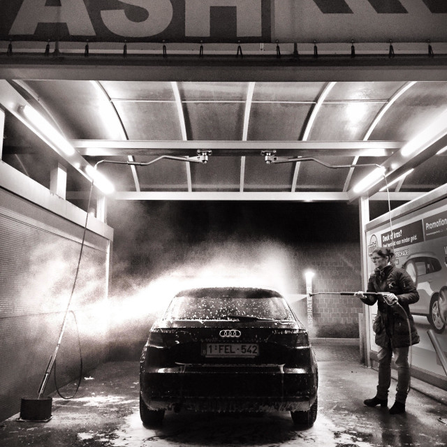 """""""Woman cleaning her car in a self service car wash"""" stock image"""