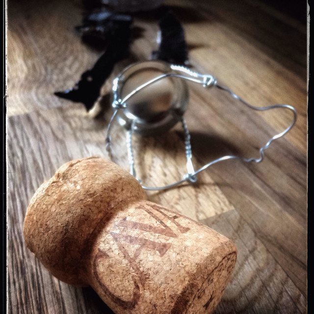 """Spanish Cava sparkling wine cork on a wooden table."" stock image"