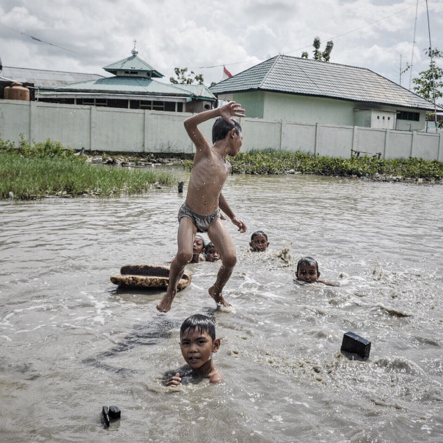 """""""""""We play outside, without gadget"""", Kuala Tungkal, Indonesia (7/1)"""" stock image"""