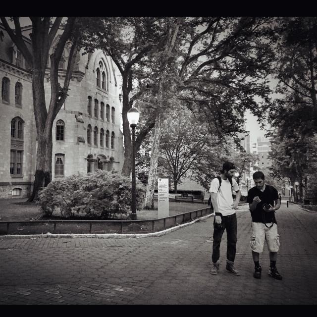 """Photographers on campus"" stock image"