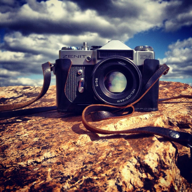 """""""Zenit TTL camera on the rock. Product of The USSR."""" stock image"""