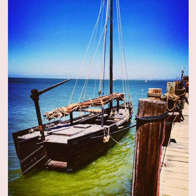 """""""An ancient fishing boat parking beside the fishman wooden jetty at China Camp State Park, CA"""" stock image"""