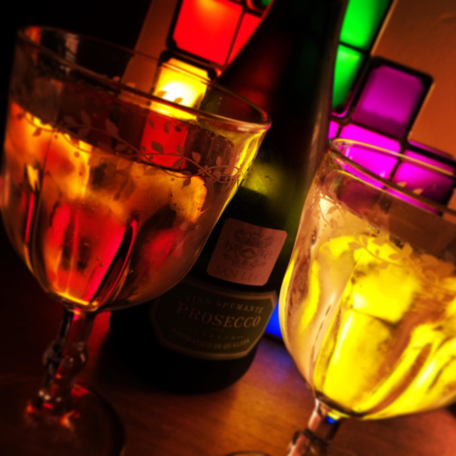"""Glasses of Prosecco against coloured cubes"" stock image"