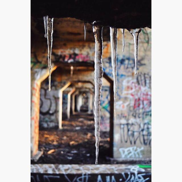"""""""Icicles at a graffitied pier"""" stock image"""