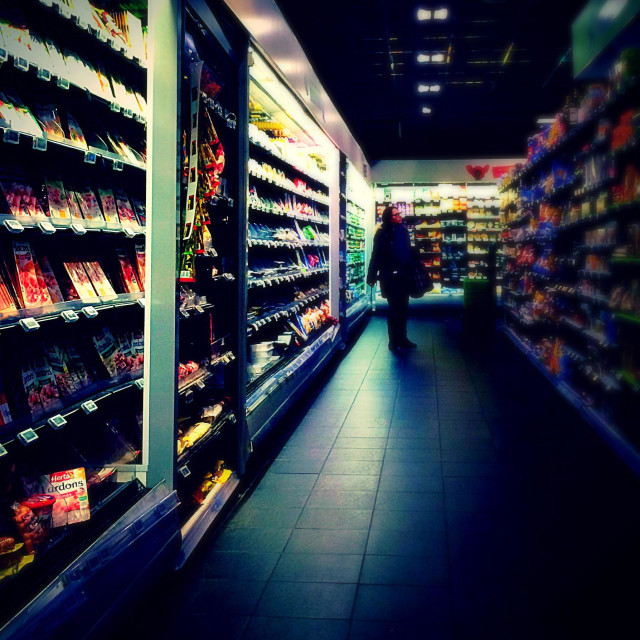 """""""French grocery shopper browsing supermarket shelves"""" stock image"""