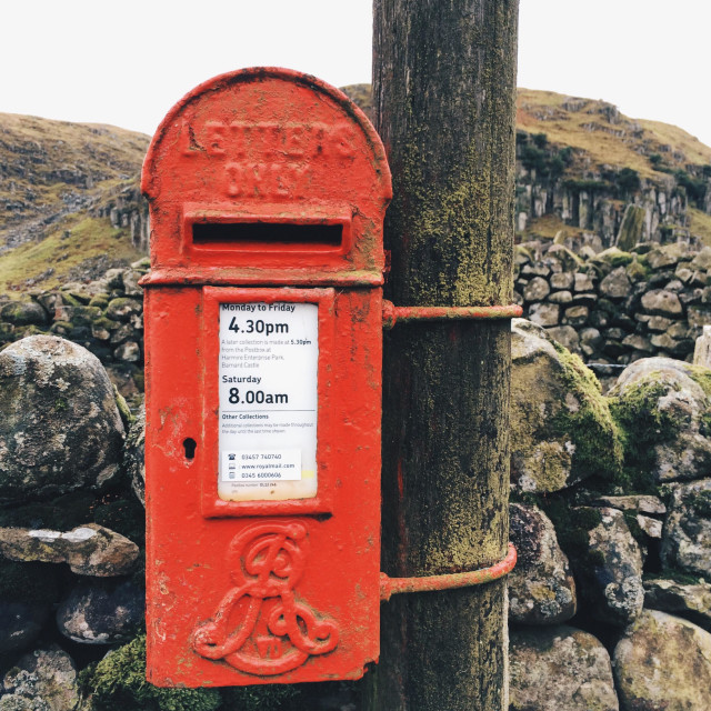 """""""A small traditional red Royal Mail letter box in rural Teesdale, UK."""" stock image"""