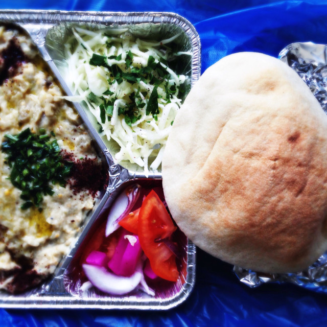 """""""The arab appetizer dish baba ganoush in takeaway packaging with a pita bread"""" stock image"""