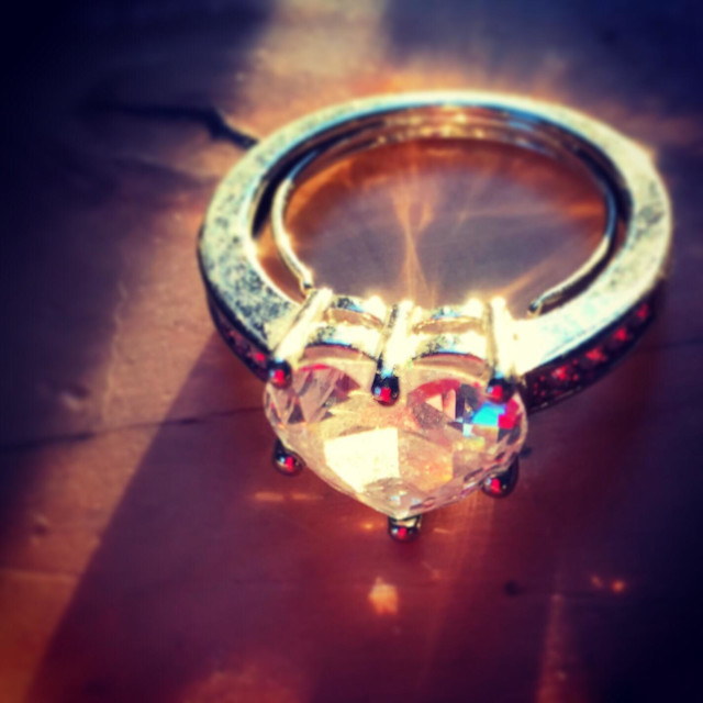 """Heart shaped ring sparkles in late afternoon sunlight."" stock image"