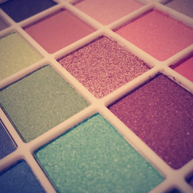 """Abstract close up view of a colorful eyeshadow palette"" stock image"