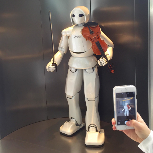 """""""Toyota partner robot on display playing the violin in Toyota Kaikan Visitor Centre in Toyota City, Japan."""" stock image"""