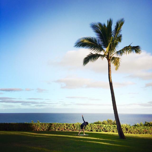 """A female person doing yoga. The Weston resort Princeville Kauai, Hawaii USA"" stock image"