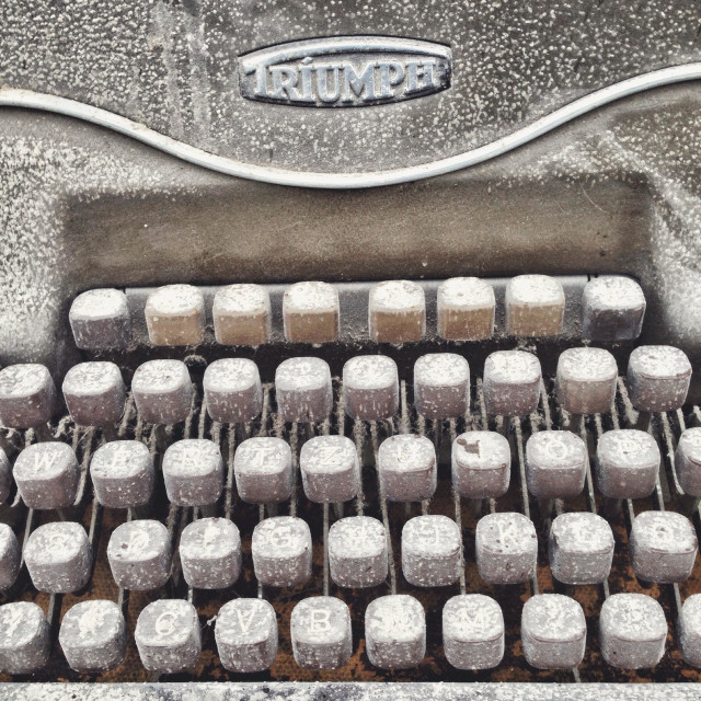 """Detail of the keyboard of a vintage dirty Triumph typewriter"" stock image"