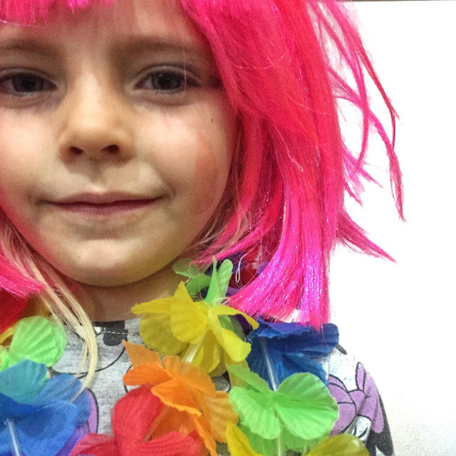 """Girl in a pink wig"" stock image"