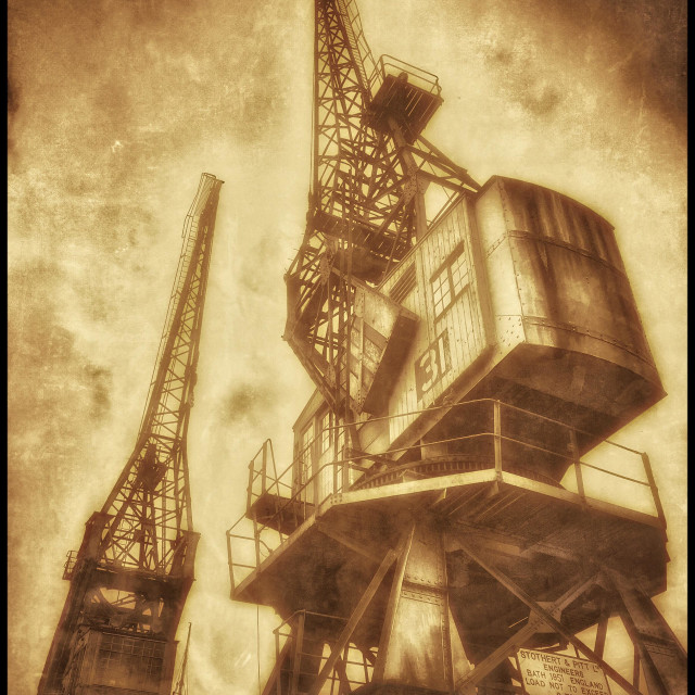 """""""A Sepia Antique Effect Picture of Two Cranes that are situated on the edge of The Floating Harbour, close to the City Centre of Bristol, England, UK. Photo Credit - © COLIN HOSKINS."""" stock image"""
