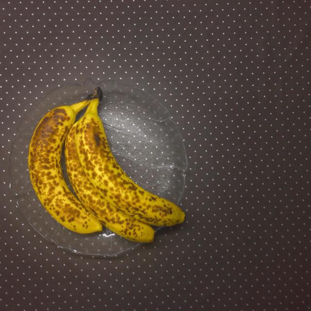 """Three Bananas on a Glas Plate"" stock image"