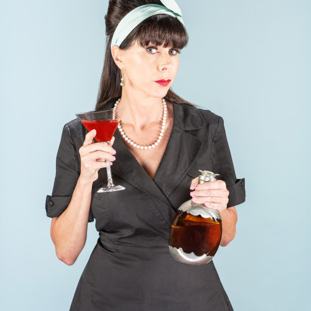 """Sultry Retro Woman in Black Dress with Cosmopolitan"" stock image"
