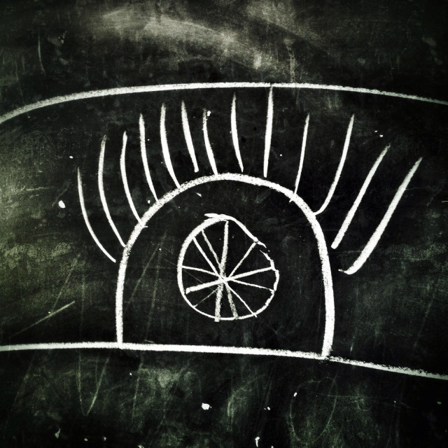 """""""A naive student's drawing of an all-seeing eye on a chalkboard at school"""" stock image"""
