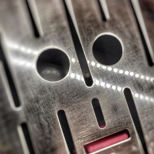 """Abstract face in a coffee machine grill"" stock image"