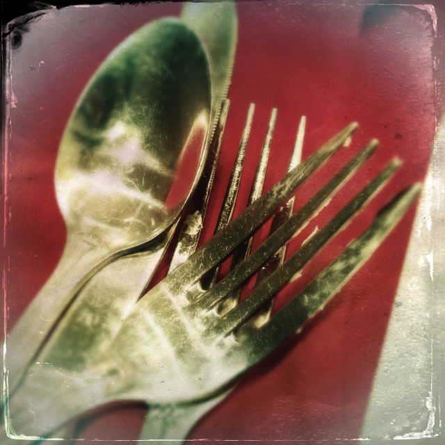"""Silverware on red cloth"" stock image"