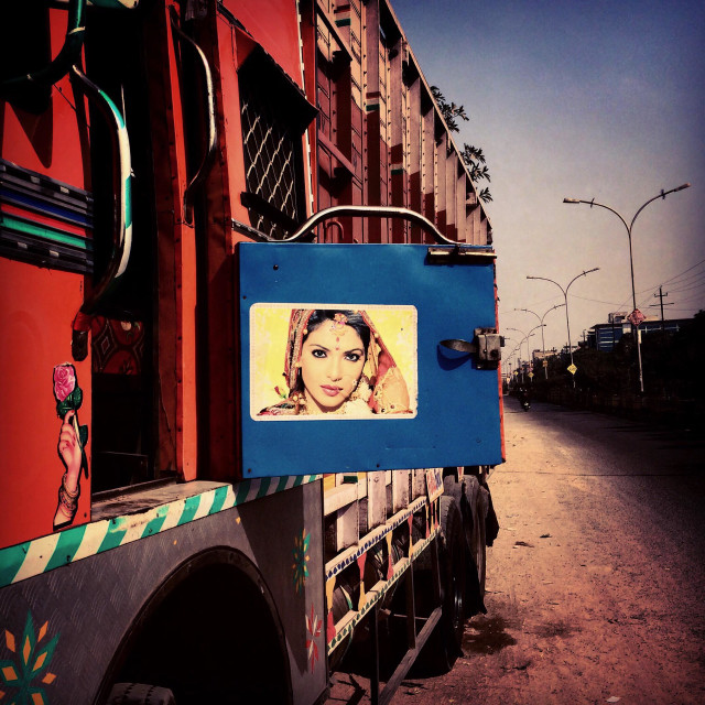"""A truck with a poster of an Indian actress in the suburbs of National Capital Territory of Delhi, India"" stock image"