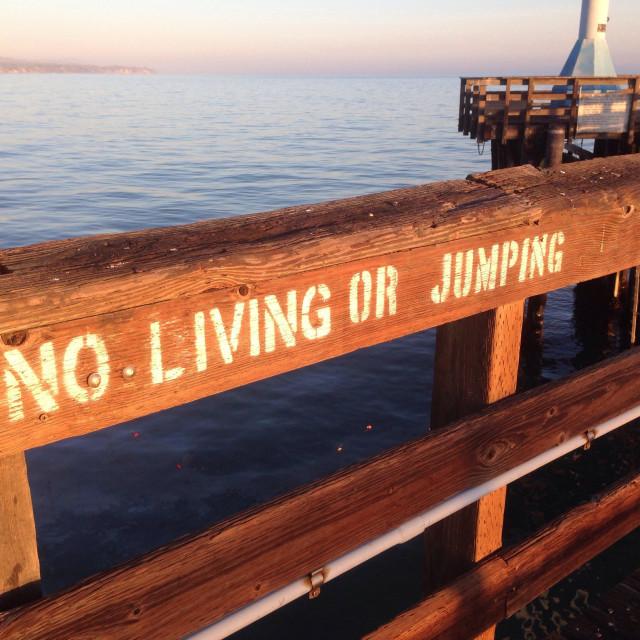 """Unique warning on pier, Goleta, California"" stock image"