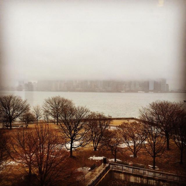 """Cloud covered New York skyline"" stock image"